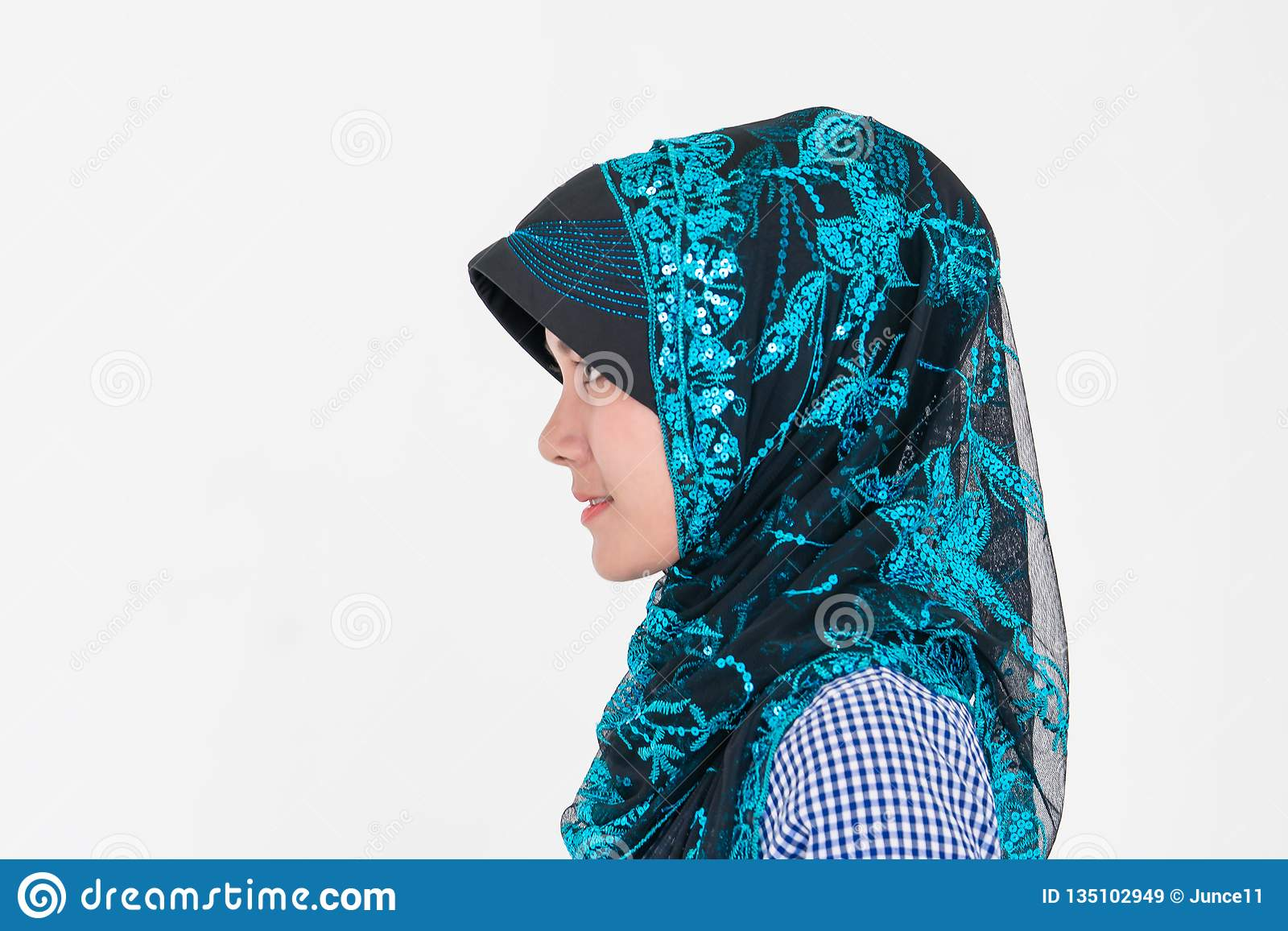 Portrait of a Muslim Islam woman on white background