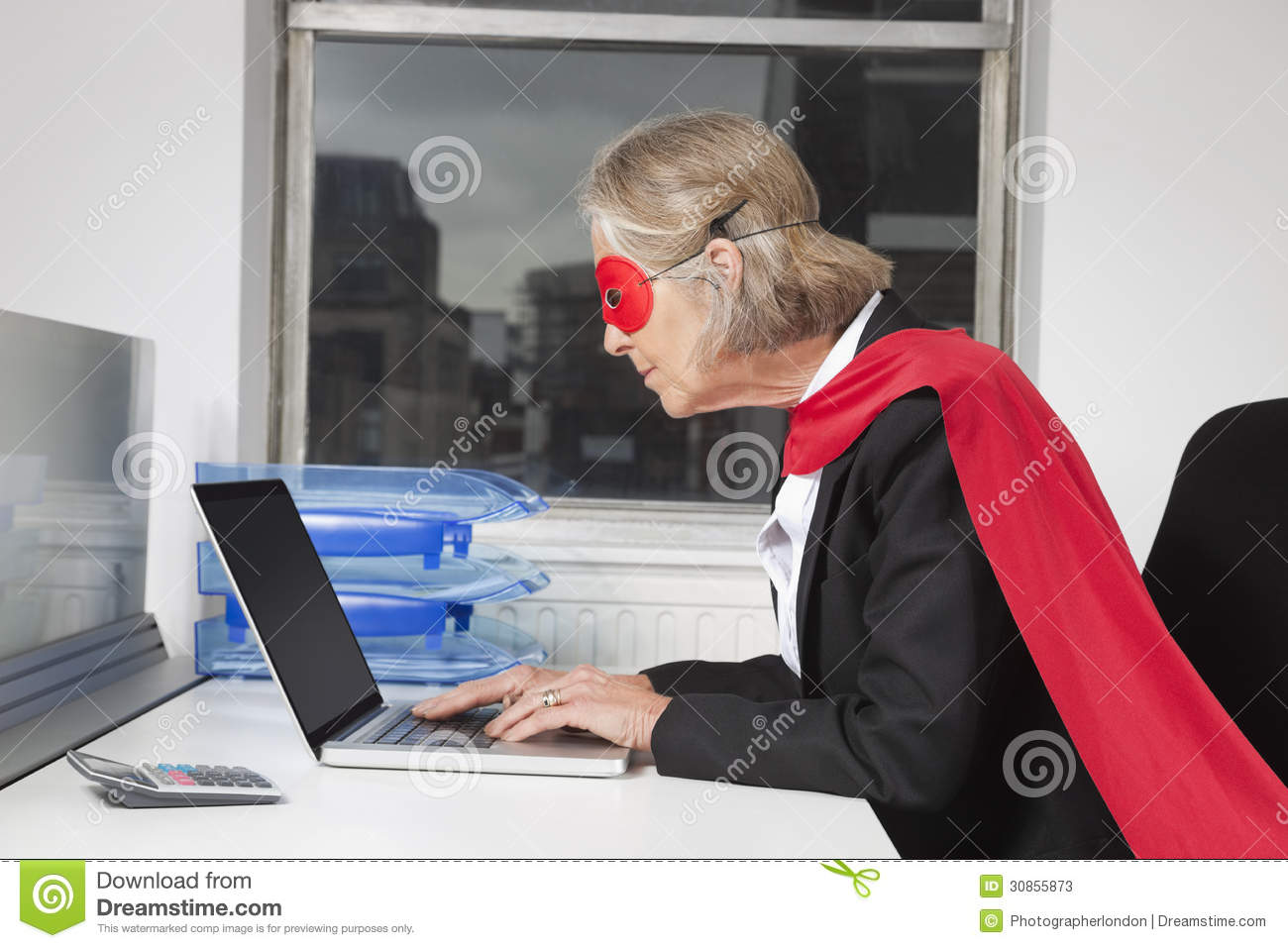Side View Of Senior Businesswoman In Superhero Costume