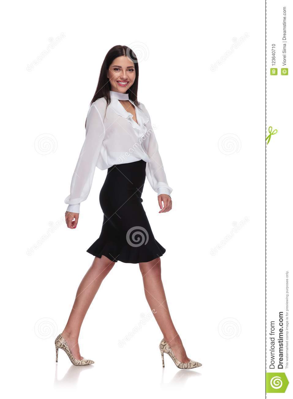 Side view of businesswoman in black skirt stepping
