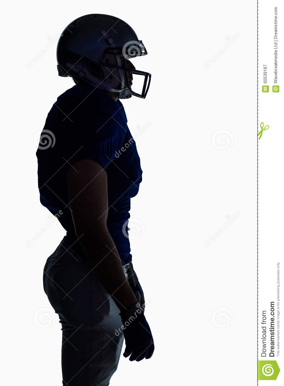 side view of silhouette american football player standing