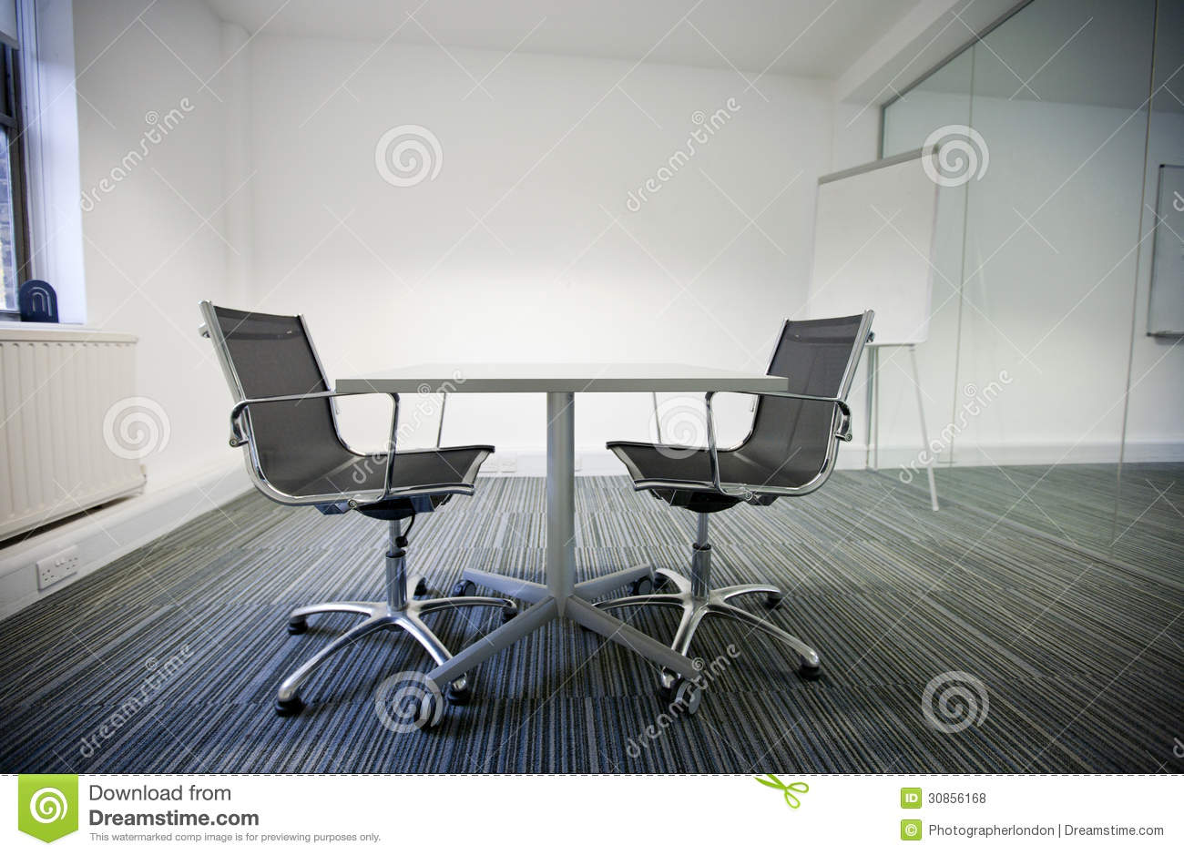 Side View Of Small Table And Two Chairs In Office Stock