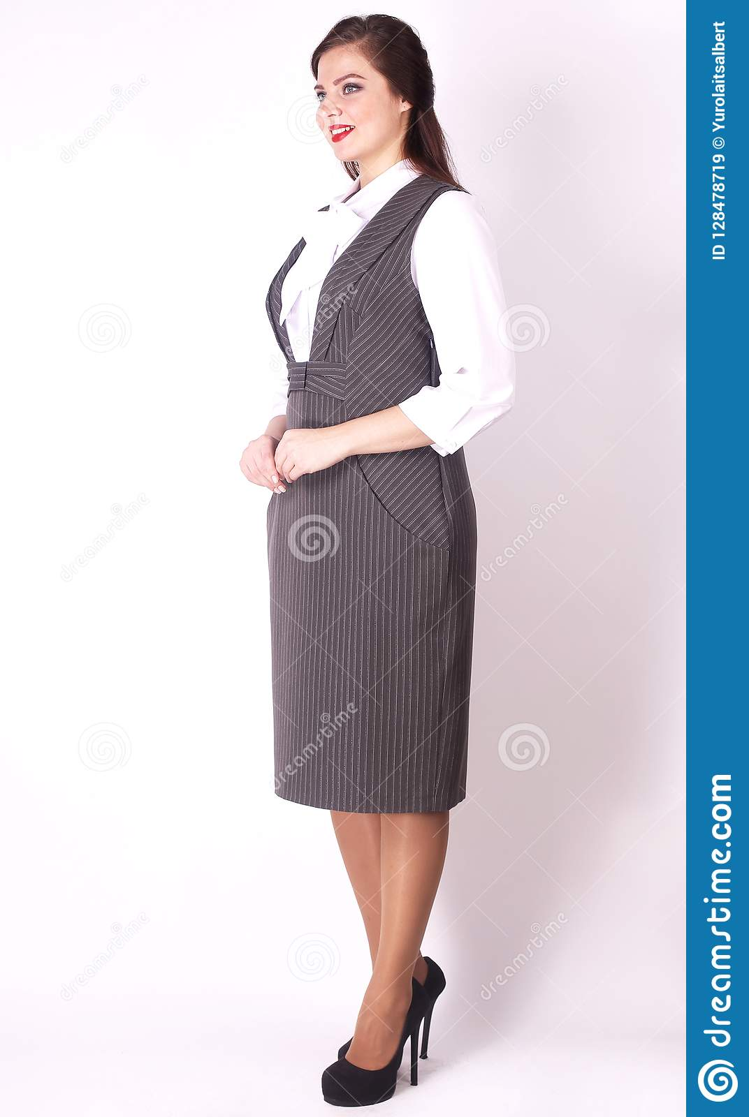 Side View. Stylish Female Model In Business Dress .plus Size Stock ...
