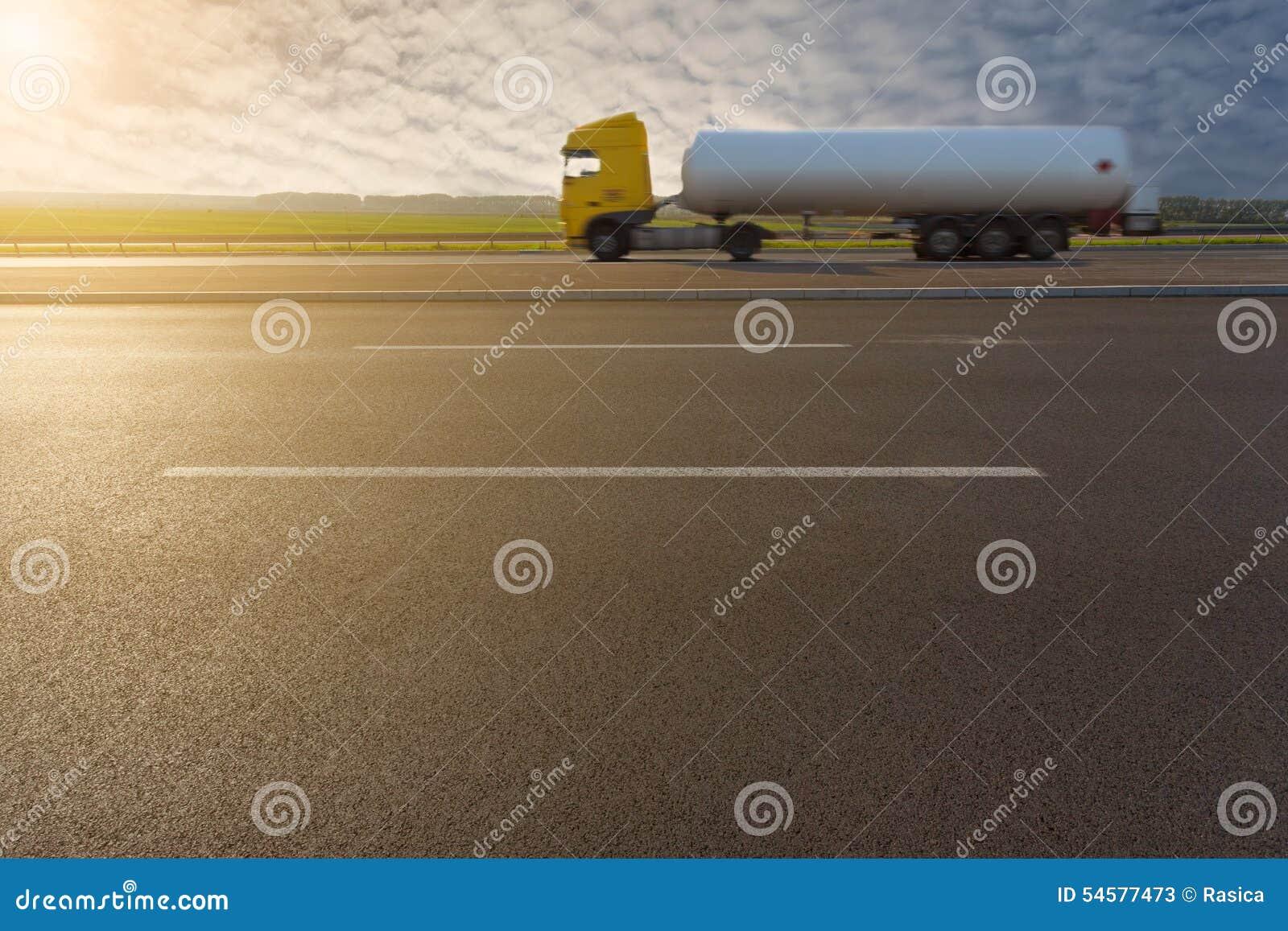 Side view on tank truck in motion blur on motorway