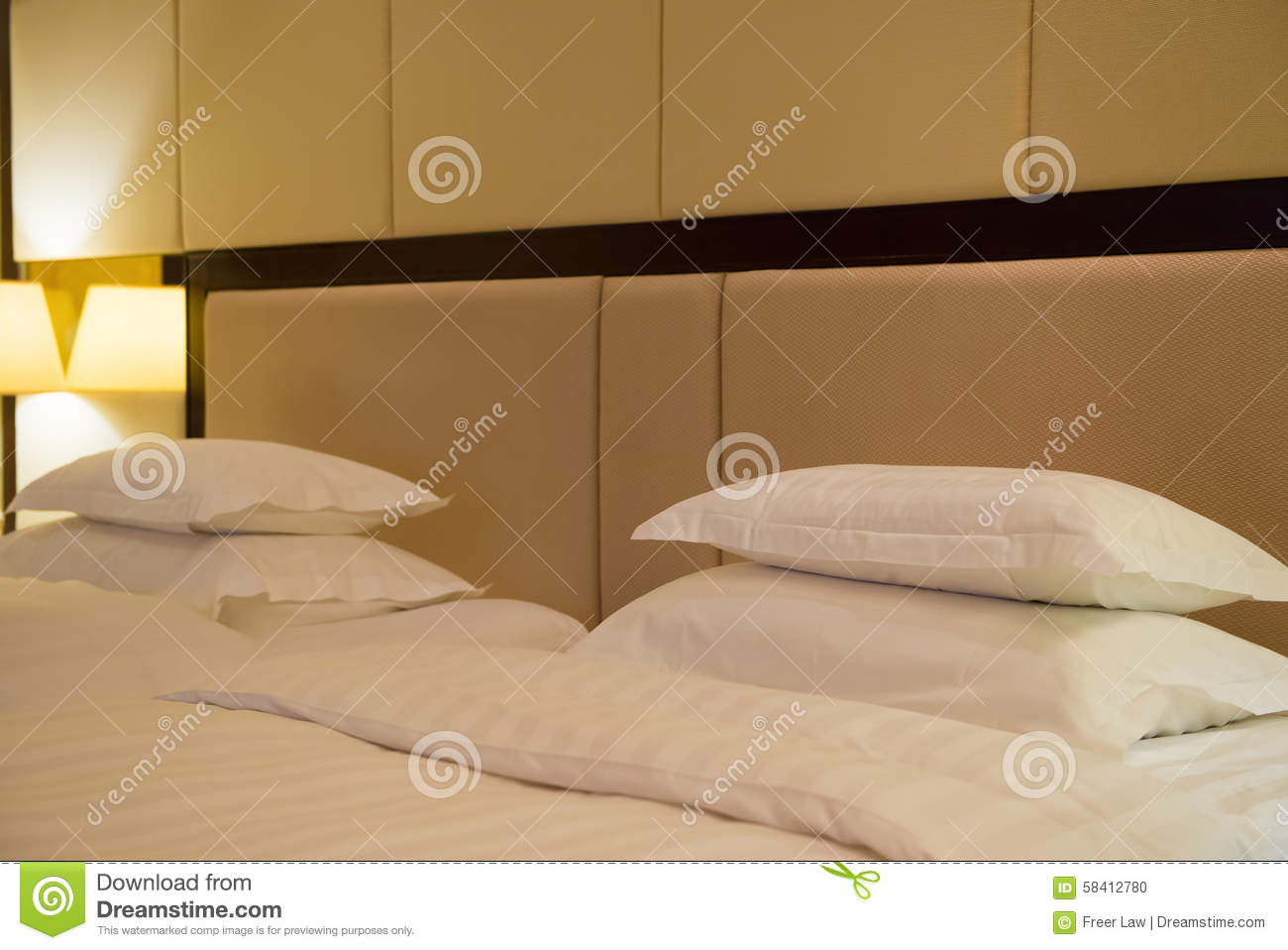 Side view of two beds in hotel room