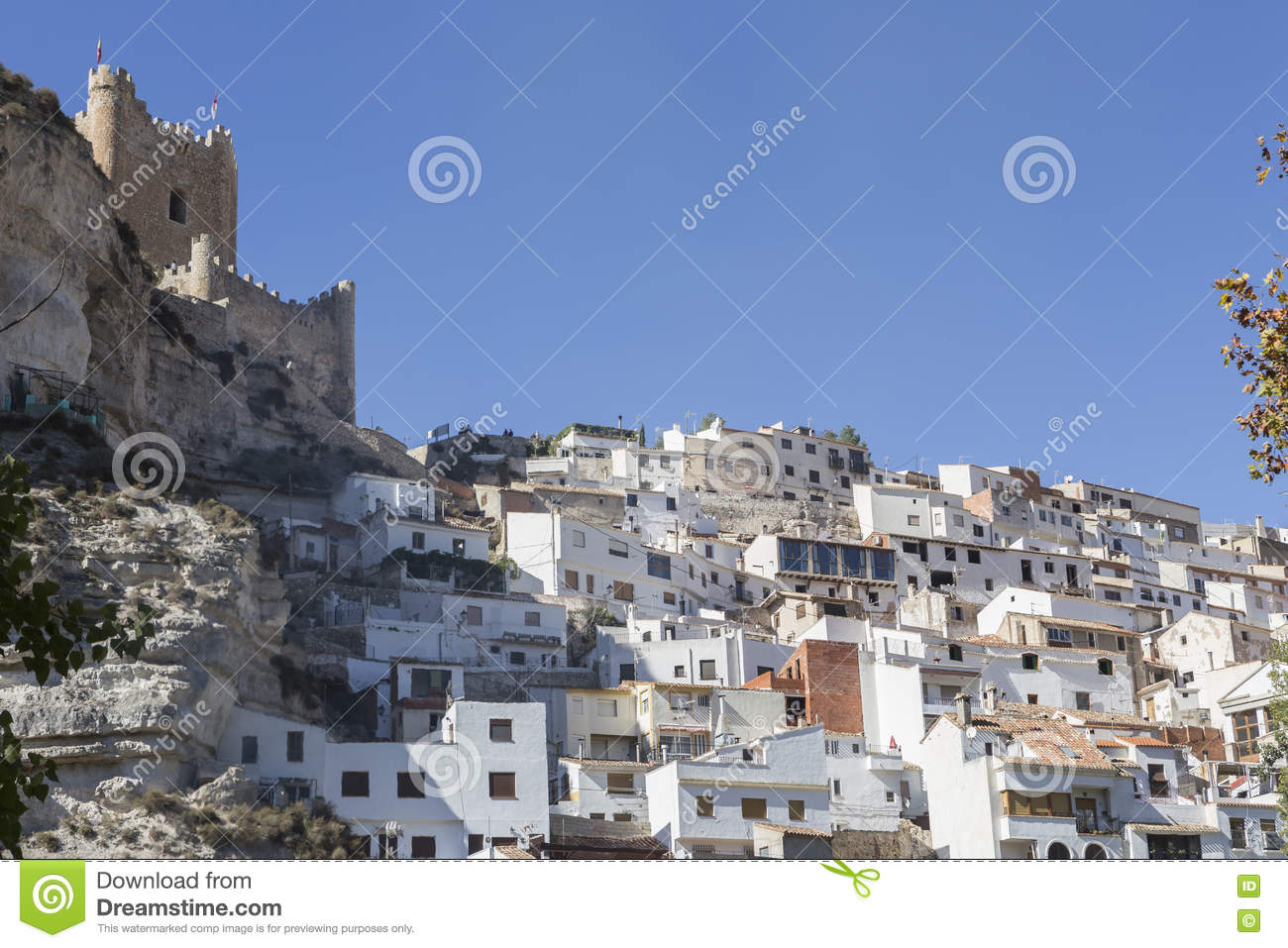 Side view of the village, on top of limestone mountain is situated Castle of the 12TH century Almohad origin, take in Alcala of t