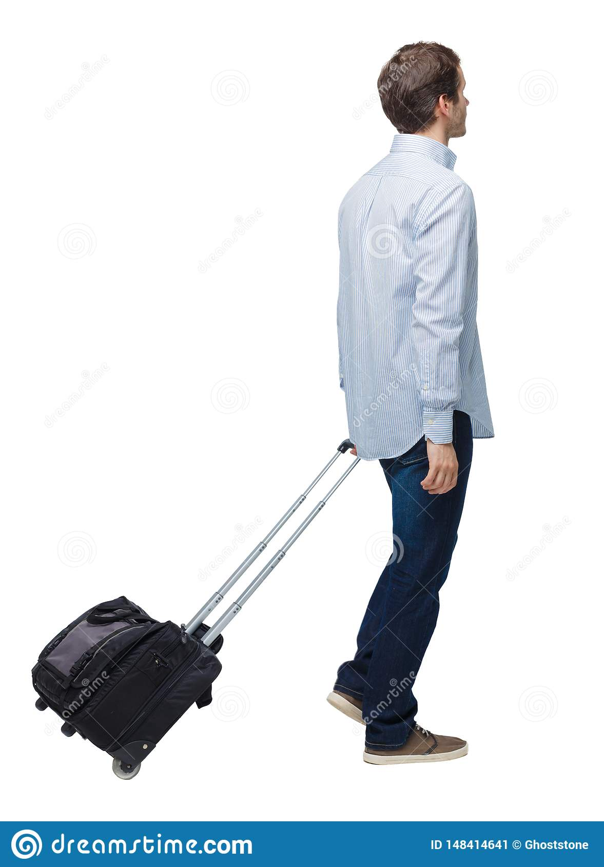 Side view of walking business man with suitcase talking on the phone