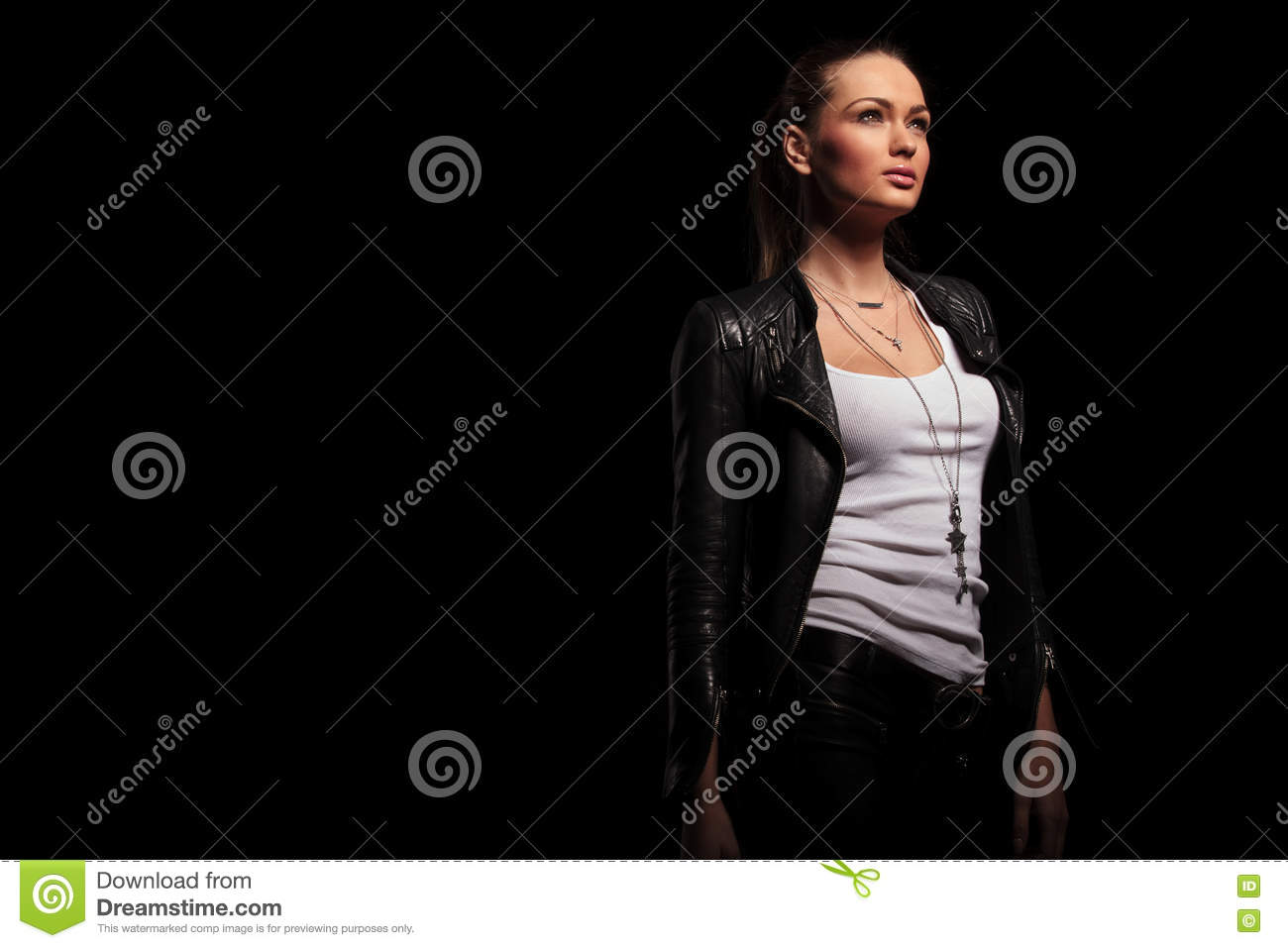 Side view of a woman in leather clothes looking up