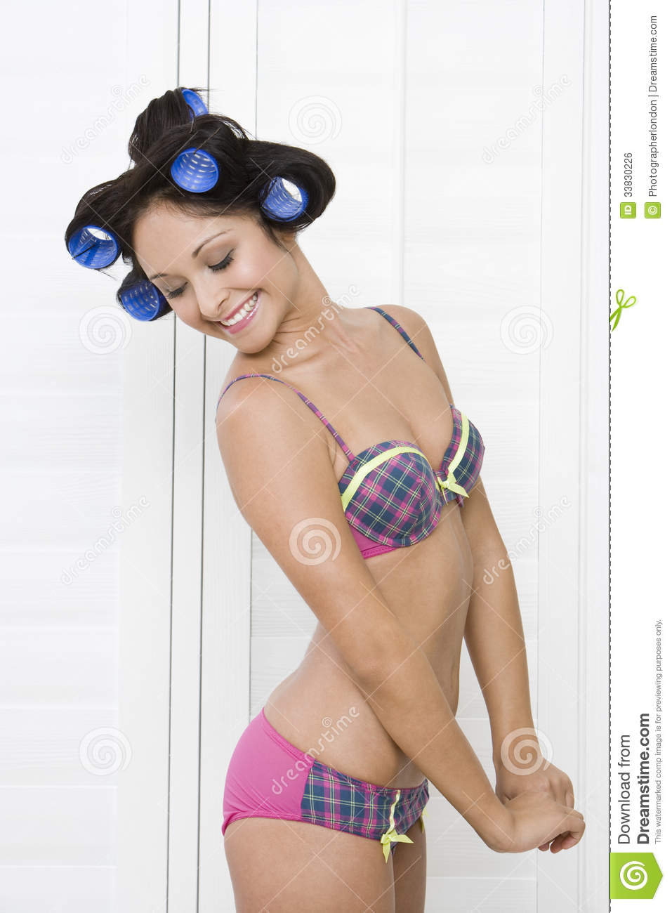 Side View Of Woman In Underwear And Rollers Royalty Free