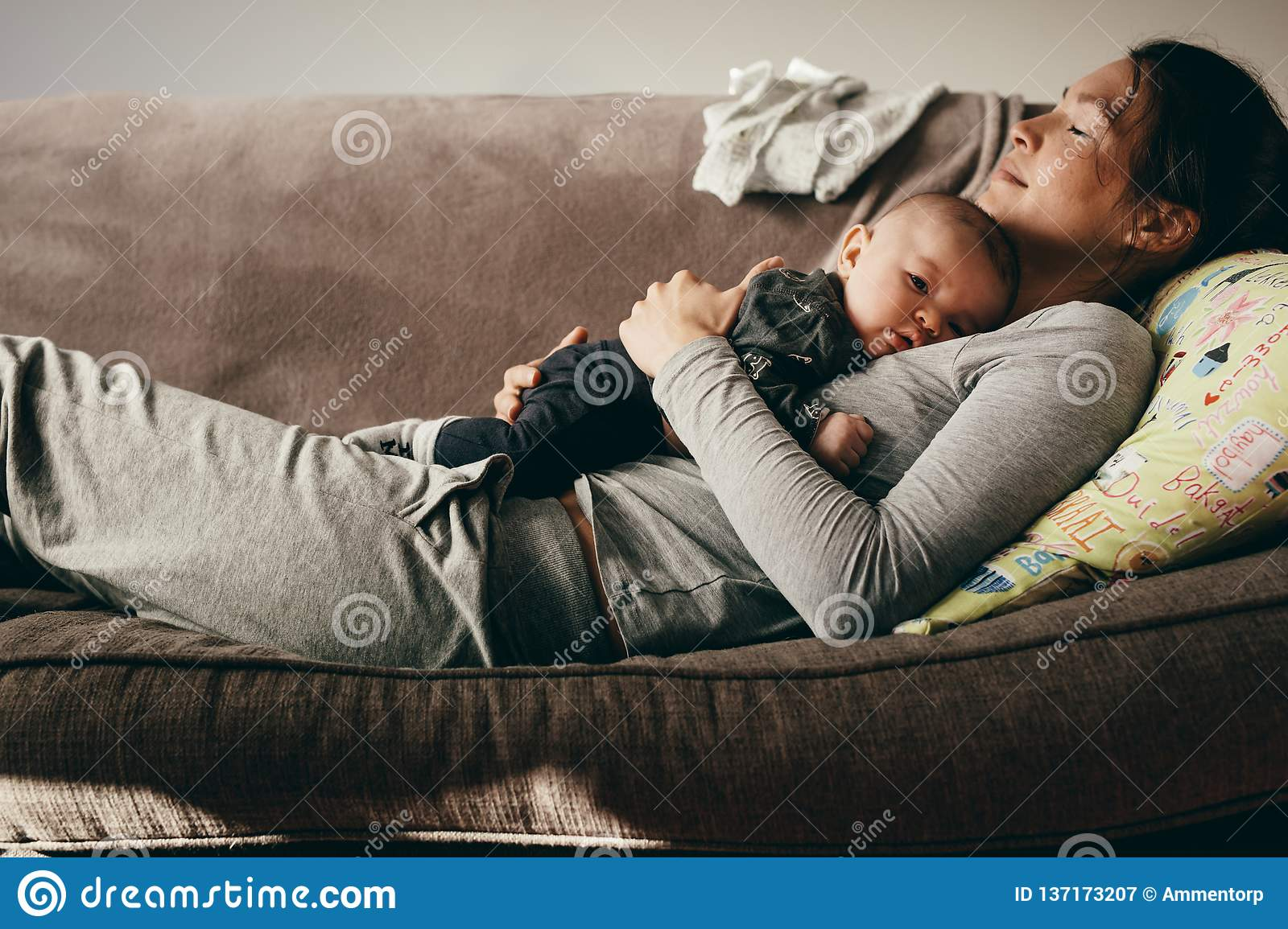 Fantastic Mother Sleeping On A Couch With Her Baby On Her Stock Image Machost Co Dining Chair Design Ideas Machostcouk