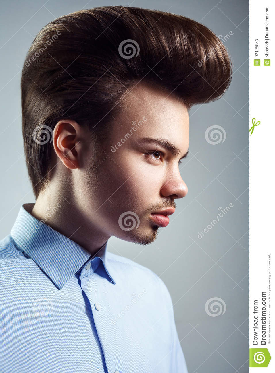 Side View Of Young Man With Retro Classic Pompadour Hairstyle Stock