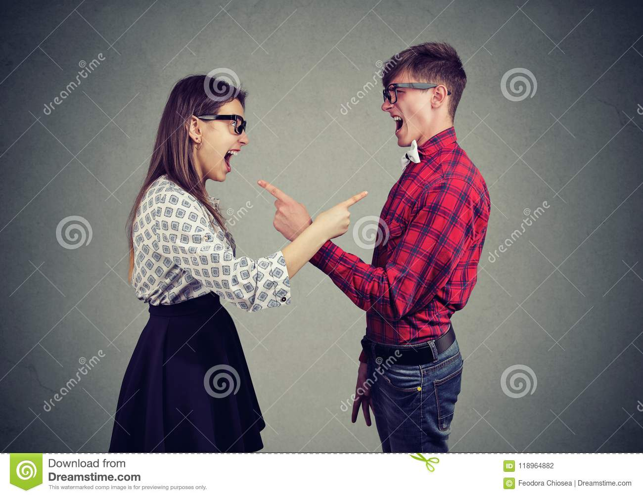 Screaming young couple having conflict