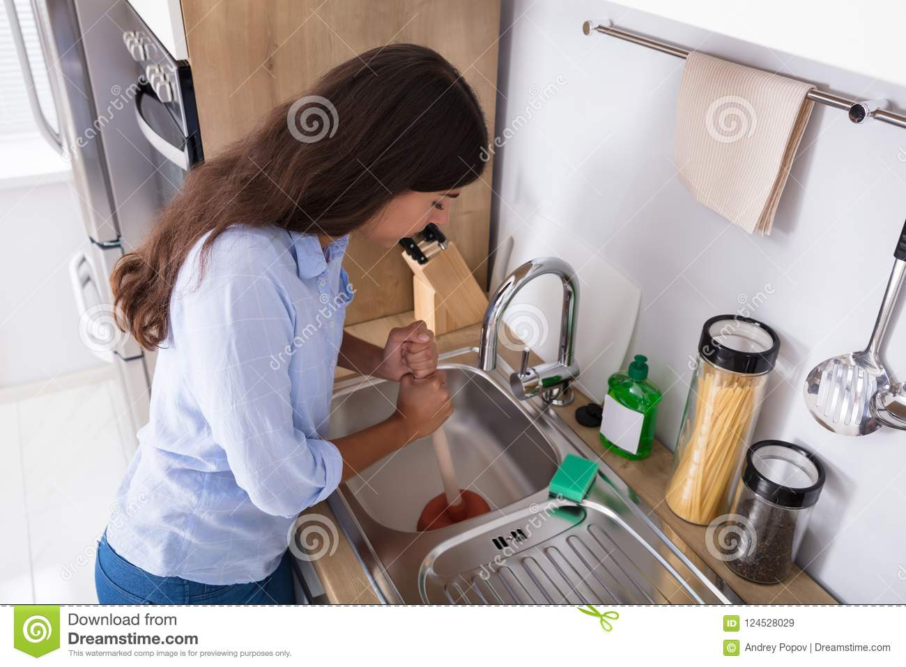 woman using plunger in blocked kitchen sink stock image image of rh dreamstime com toilet plunger kitchen sink toilet plunger kitchen sink