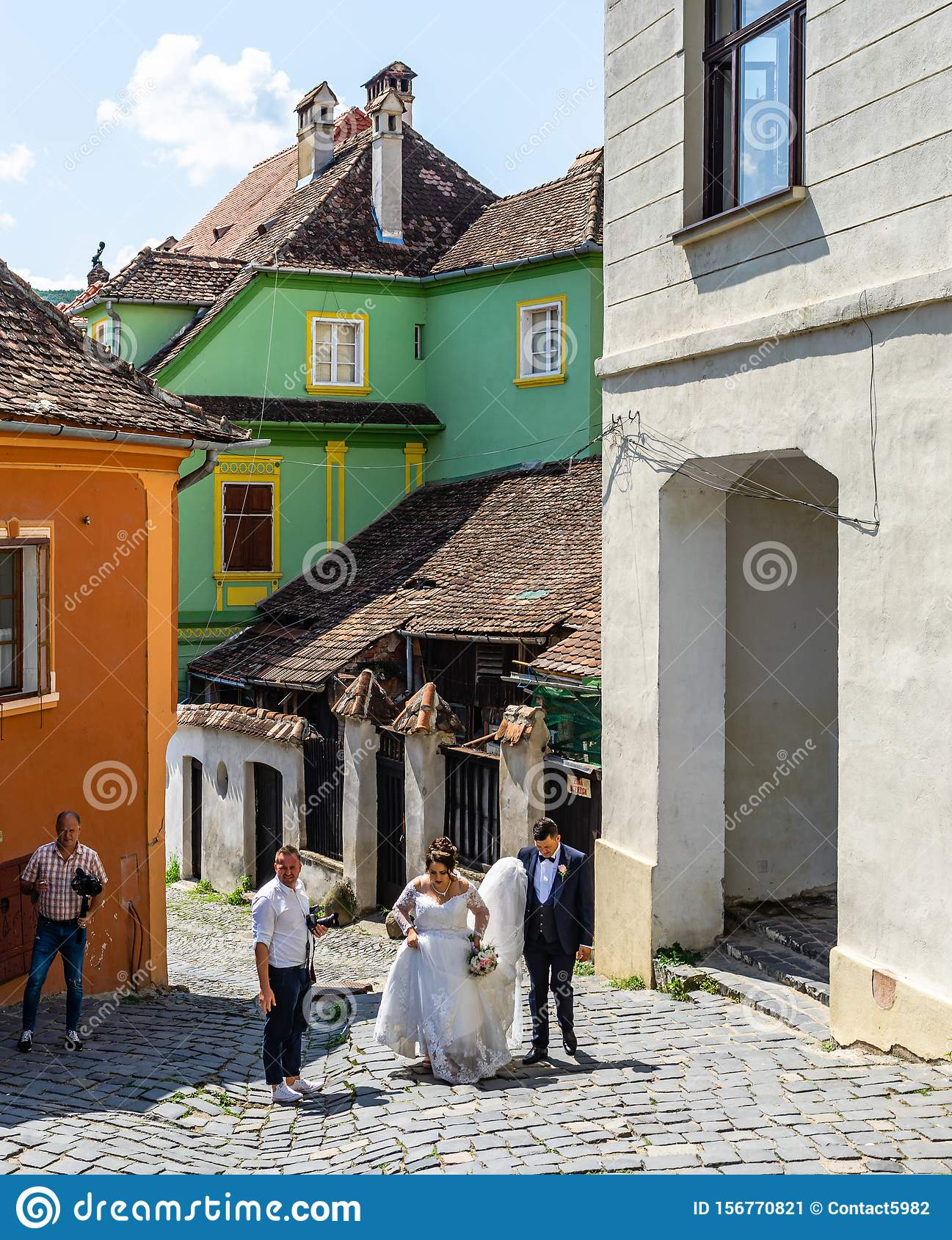 Sighisoara, Romania – 2019. Happy newly married couple preparing to take a picture