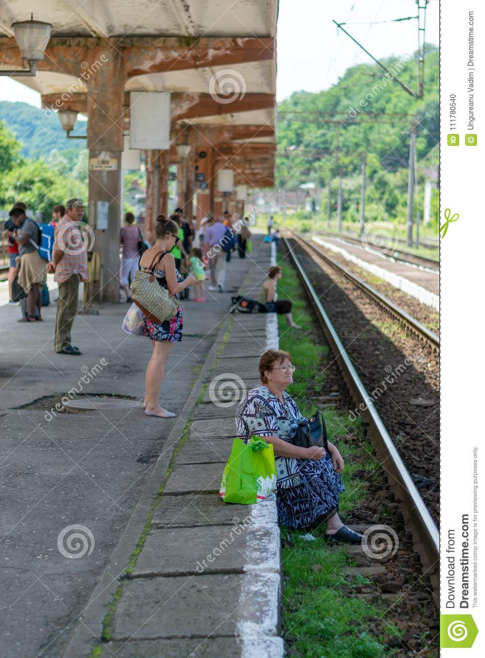 SIGHISOARA, ROMANIA - 1 JULY 2016: People waiting for the train in Sighisoara, Romania.