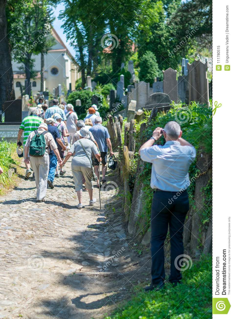 SIGHISOARA, ROMANIA - 1 JULY 2016: Tourists visiting the Saxon cemetery, located next to the Church on the Hill in Sighisoara, Rom