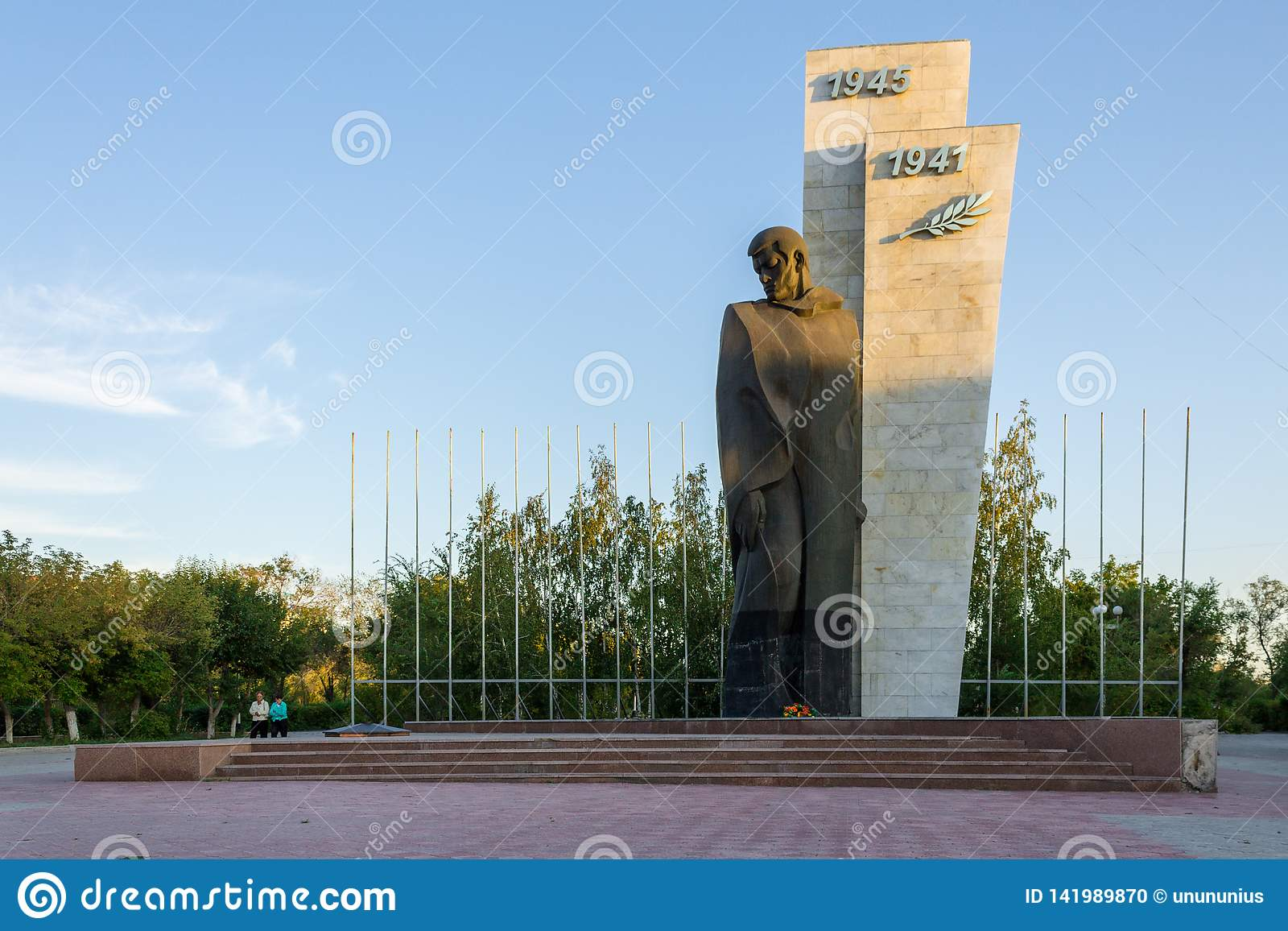 Panorama view on lonely Monument of the unknown soldier second world war. The Person is standing. Located in Temirtau, Kazakhstan