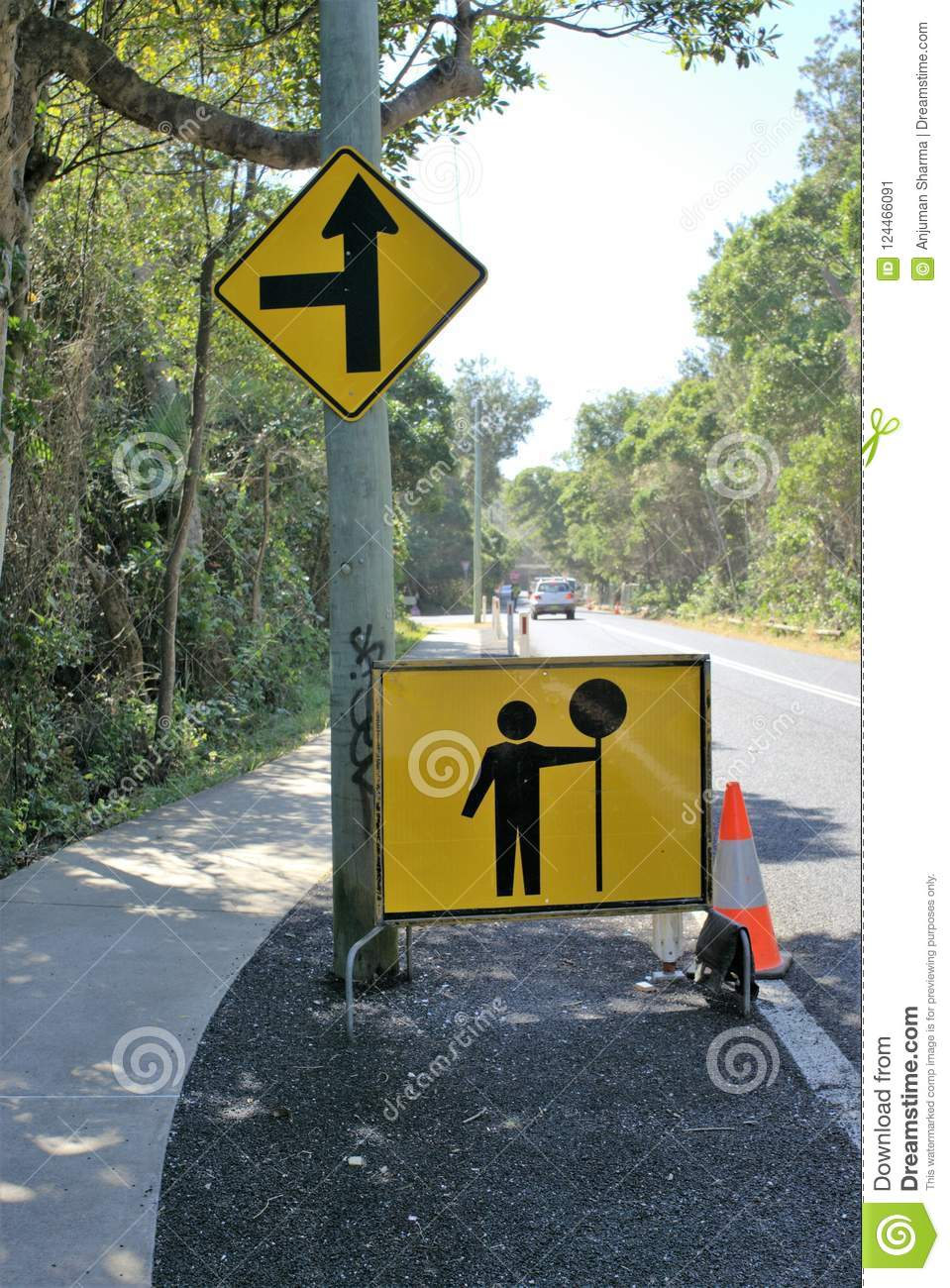 Sign board of man holding street sign for traffic changes