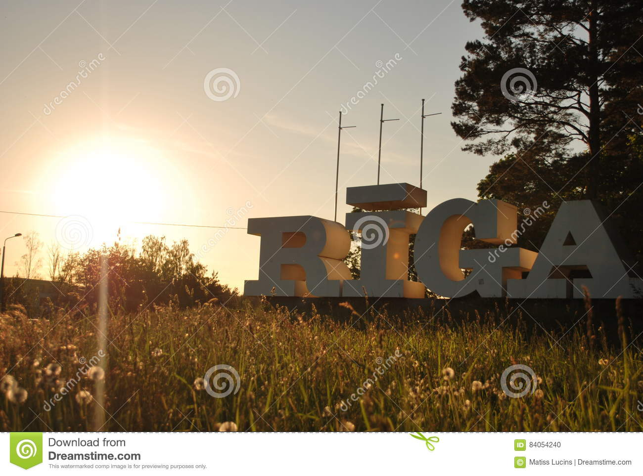 Sign of city Riga in sunset