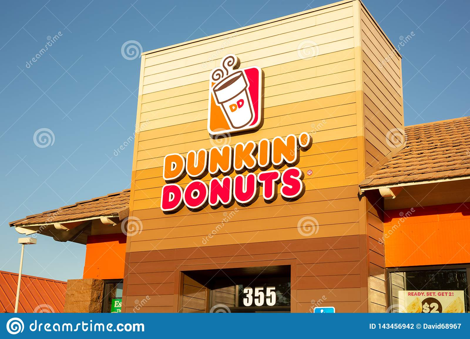 Sign for Dunkin` Donuts