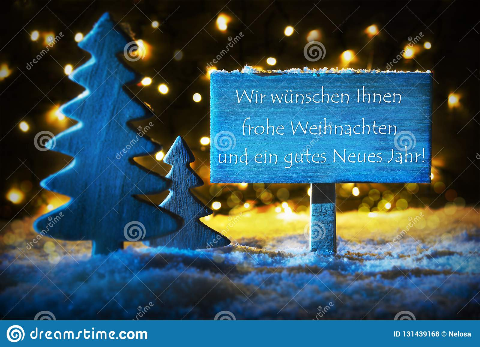Frohe Weihnachten Und Happy New Year.Blue Christmas Tree Gutes Neues Means Happy New Year Stock Photo