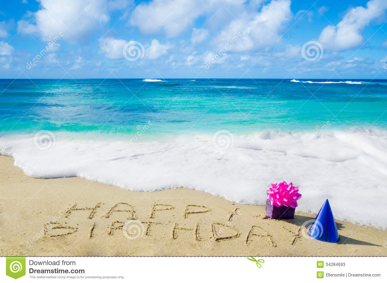 Sign Happy Birthday With Decoration On The Sandy Beach By Ocean