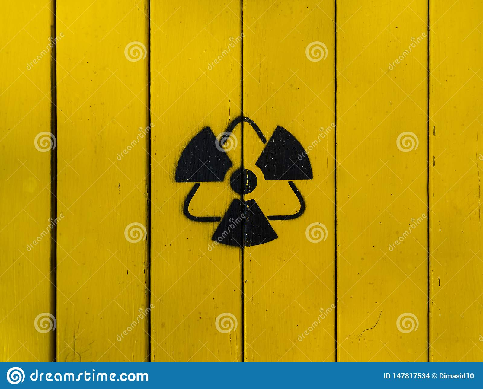 Sign of radiation on a yellow wooden board