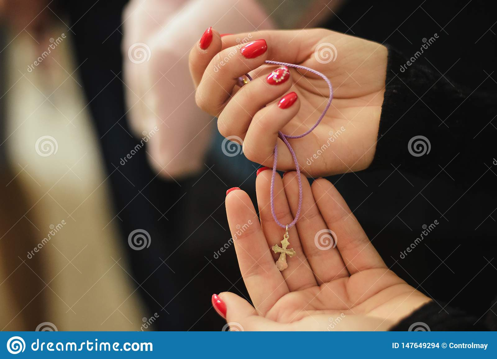Sign of religion in the hands of a girl.