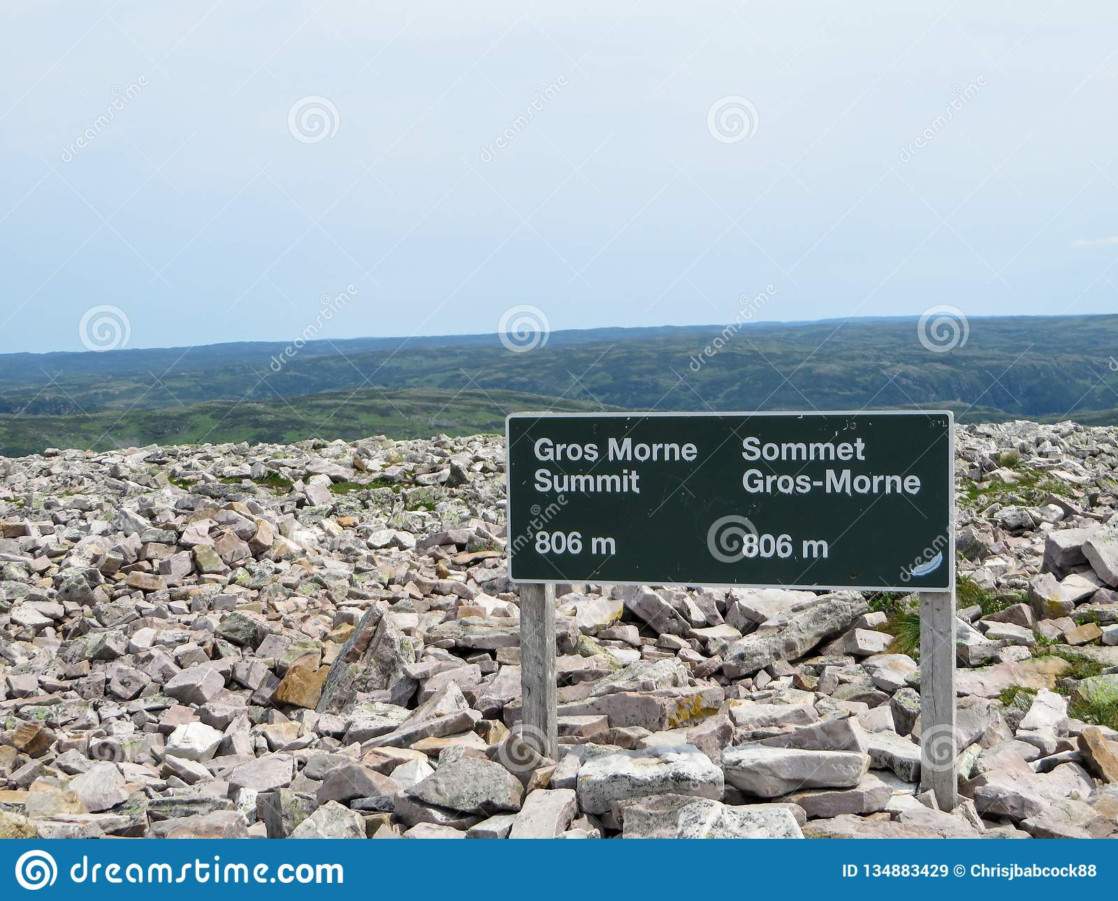 The sign at the summit of Gros Morne Mountain when hikers reach the summit.