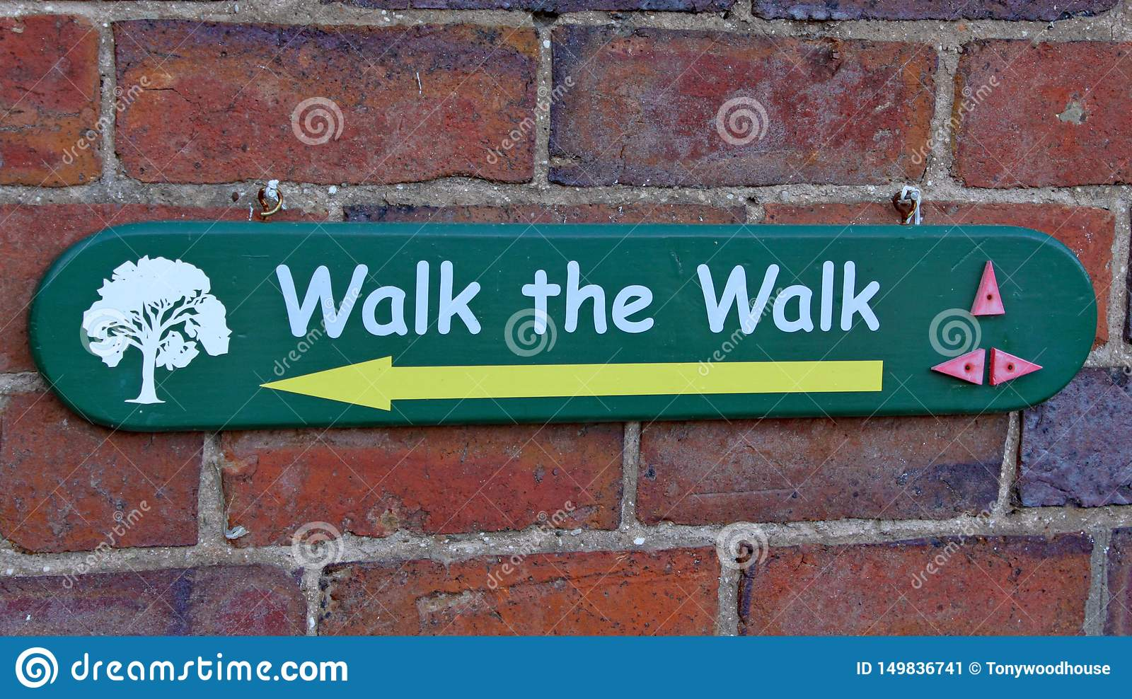 A sign telling visitors which way to walk at Arley Arboretum in the Midlands in England