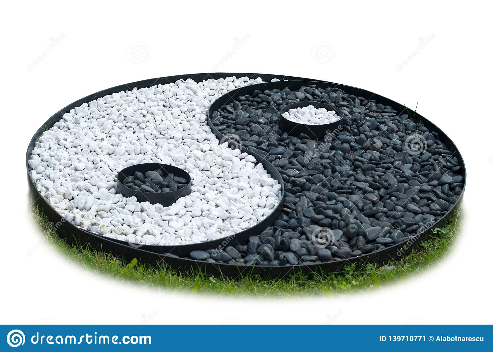 Sign of yin yang laid out of black and white stones isolated on white background