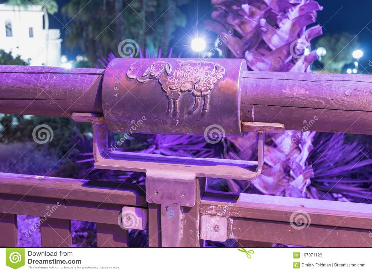 Sign of the zodiac Aries on the bridge of the Wishing Bridge in the violet light of a spotlight located on old city Yafo in Tel Av