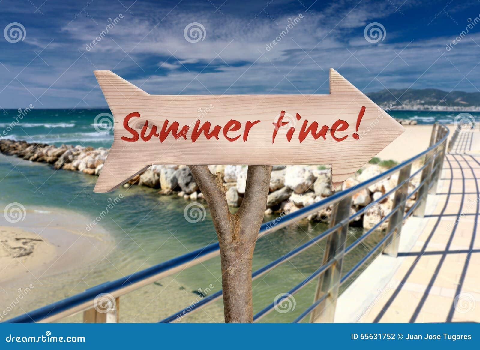 Signe en bois indiquant l heure d été