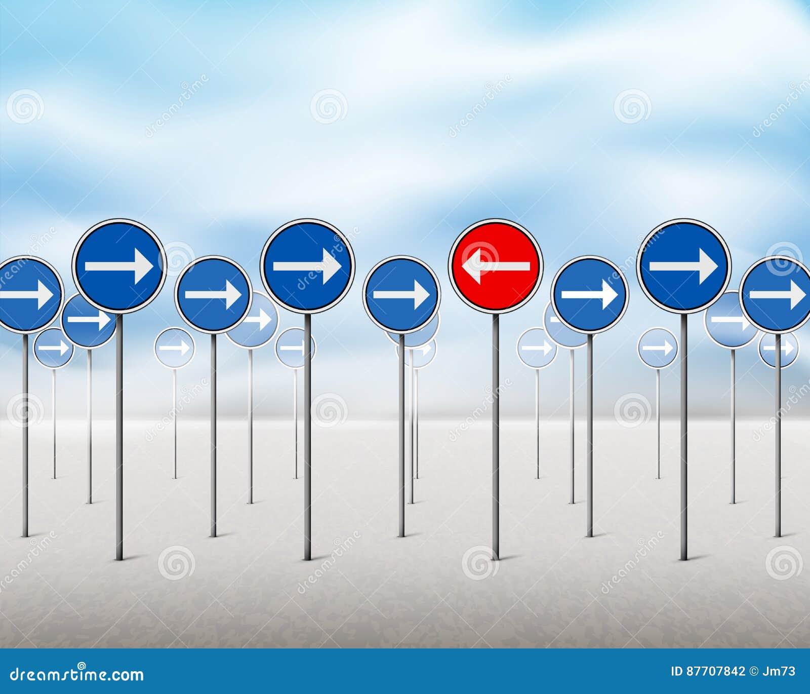 Signes bleus de flèche et un pointage rouge dans la direction opposée
