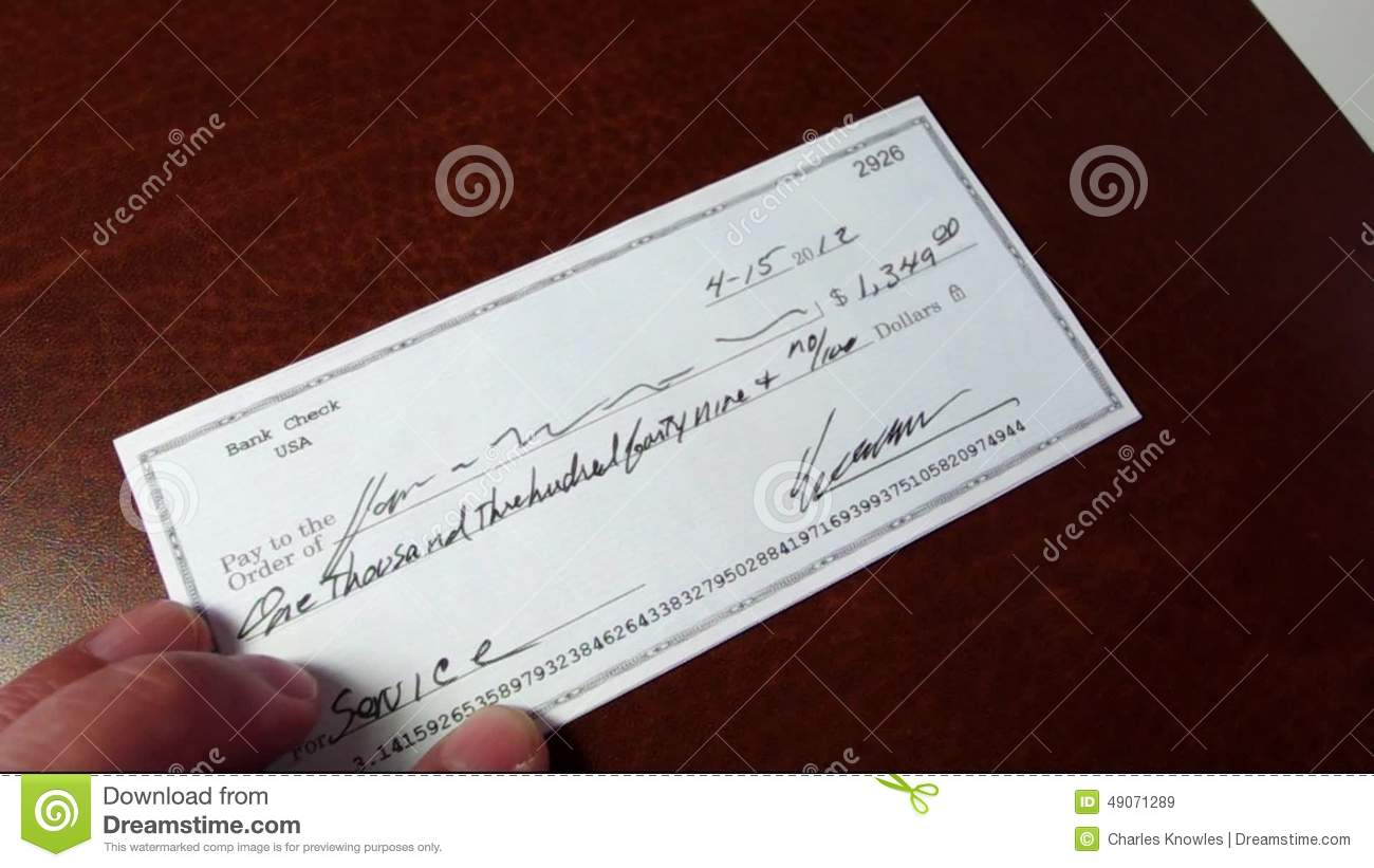 Signing A Check And Stamping It Reject Stock Video - Video: 49071289