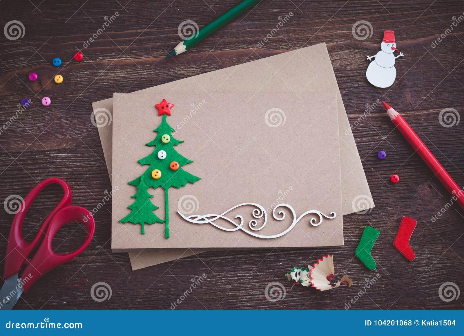 Signing Handmade Christmas Card With Felt Christmas Tree Snowflakes