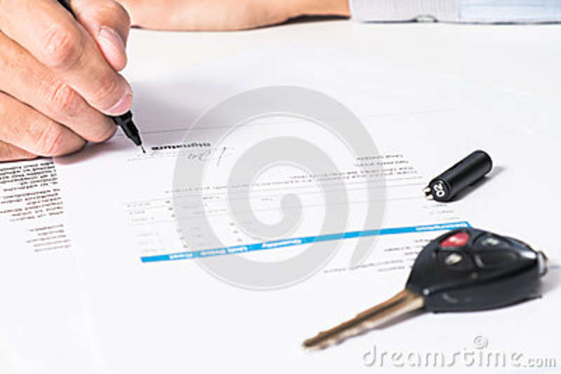signing pen and car key for vehicle sales agreement stock photo