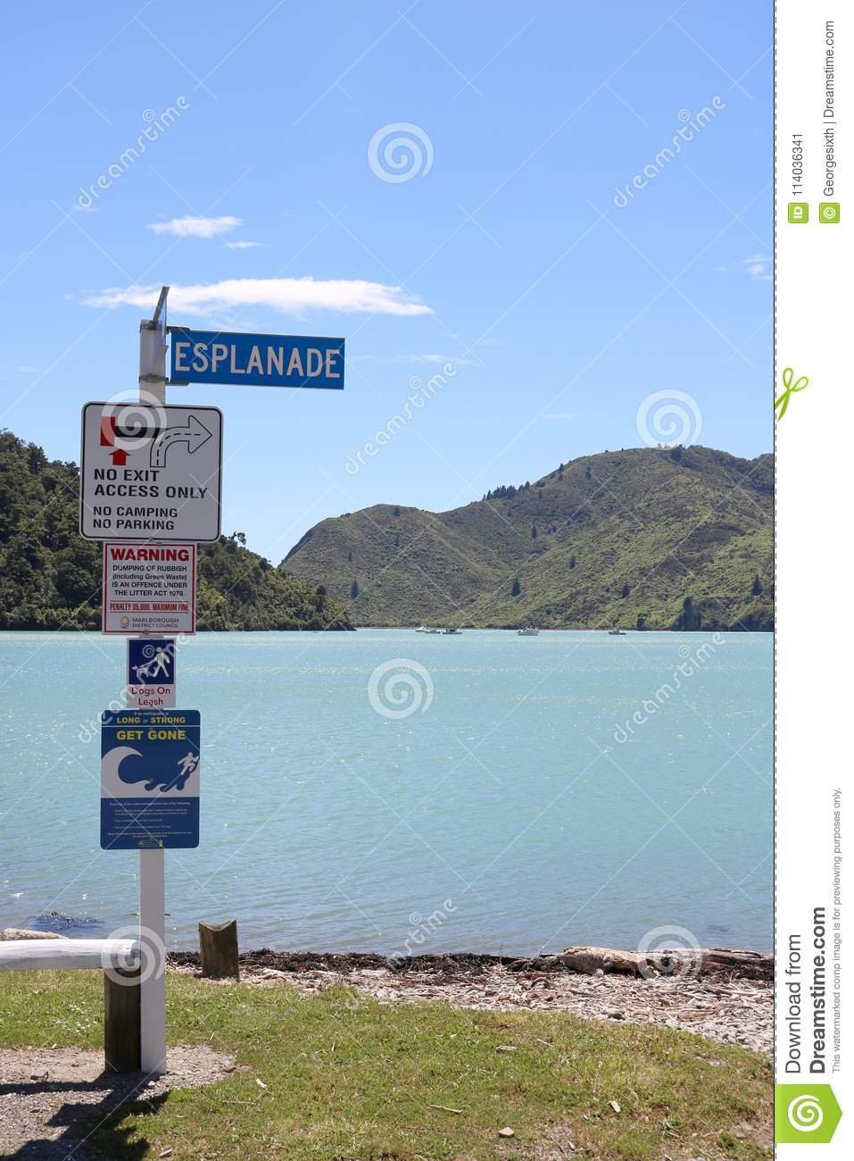 Road And Warning Signs, Okiwi Bay, New Zealand Editorial Photo