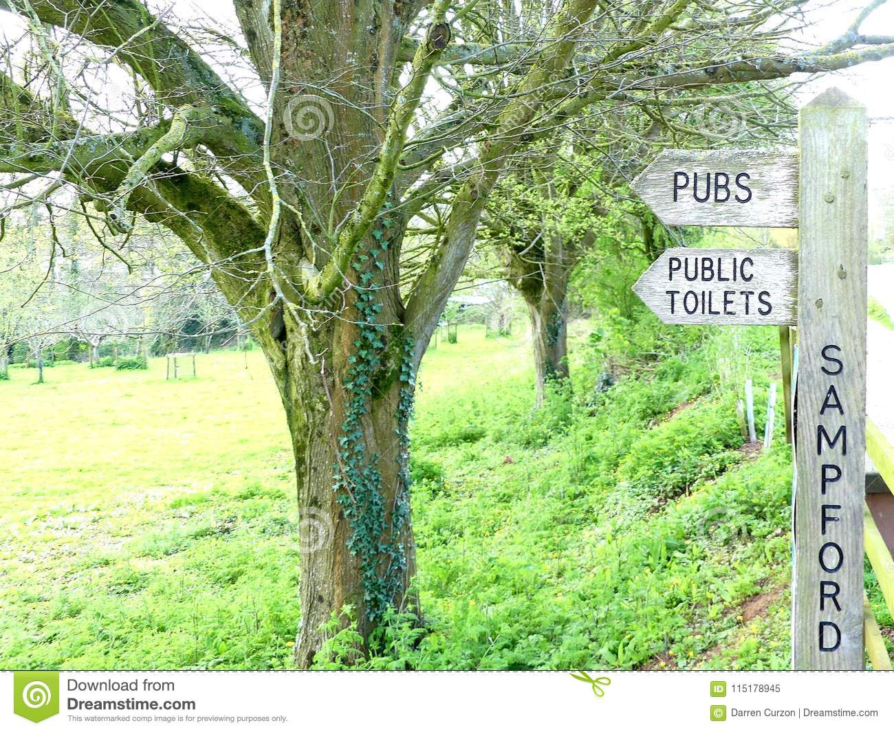 A Signpost In Sampford Peverell, Devon, Directing Towards Pubs And ...