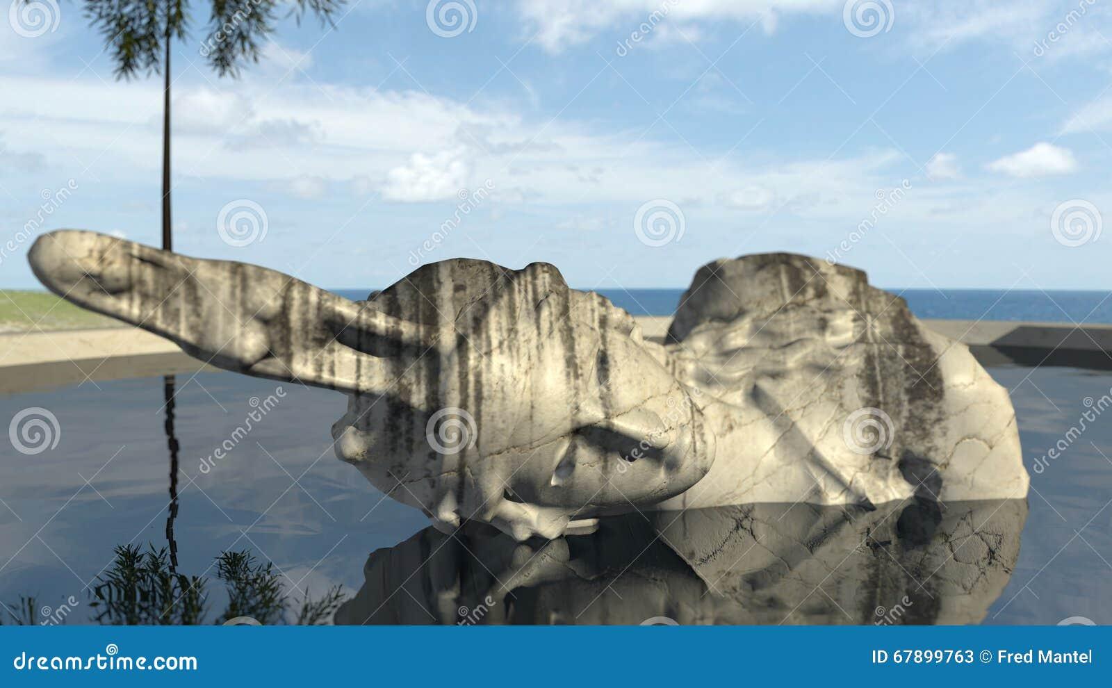 Sigue habiendo la escultura antigua un viejo en el agua