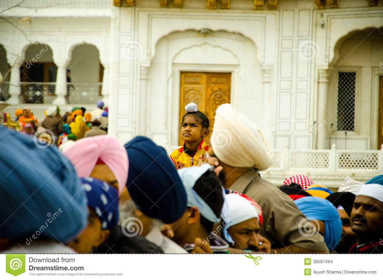 A Sikh boy at Golden Temple Crowd
