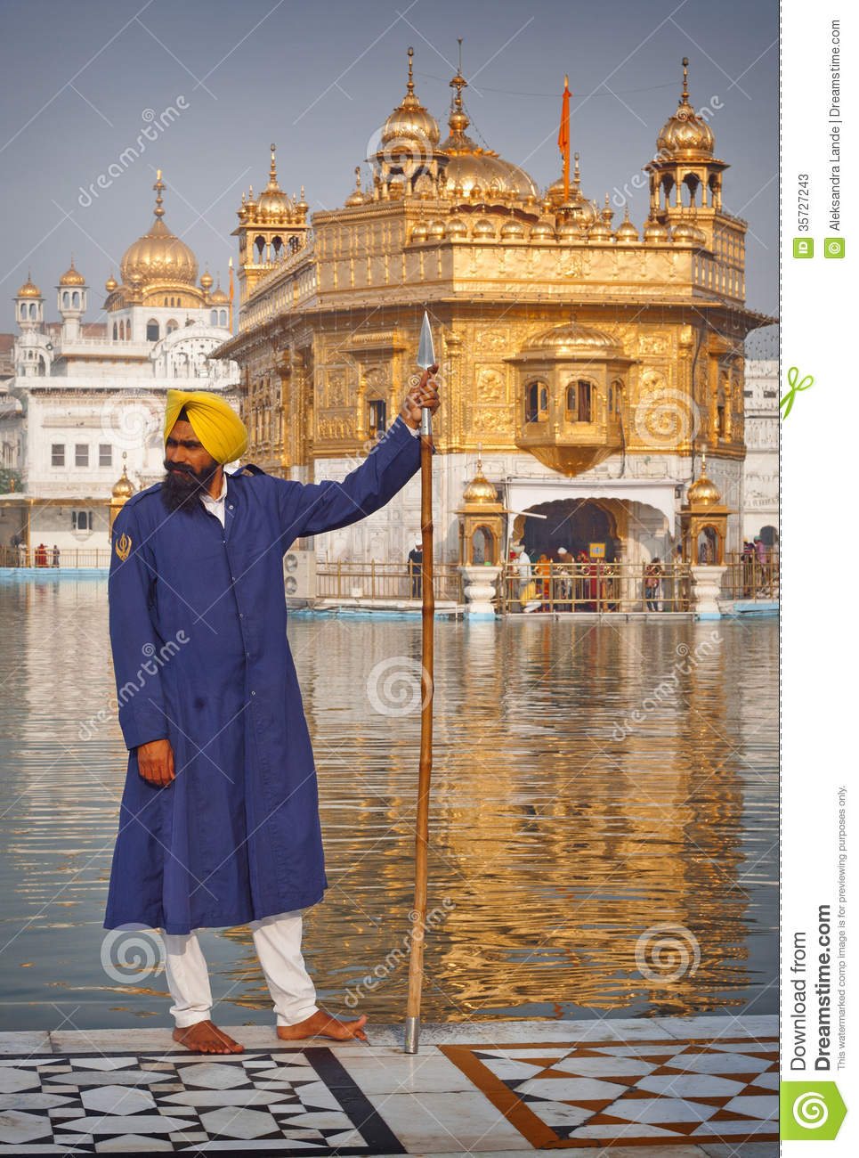 sikh pilgrims in the golden temple editorial stock photo