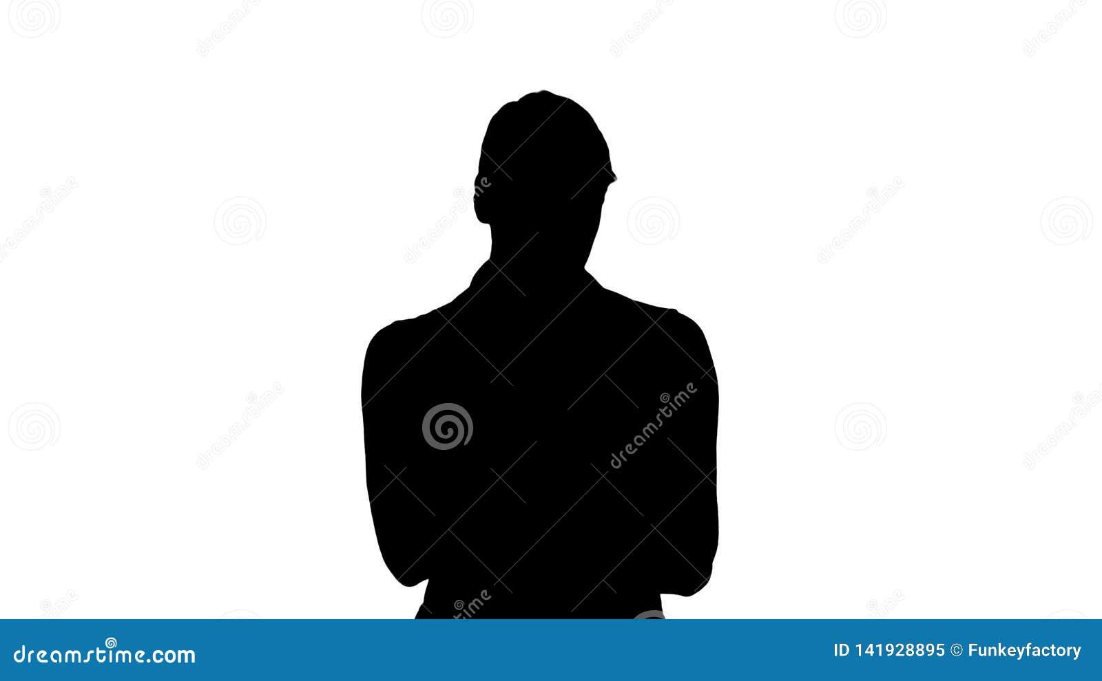 Silhouet die mooie vrouw met blondehaar charmeren, gebruikt zij haar digitale tablet voor het letten op foto s en video s