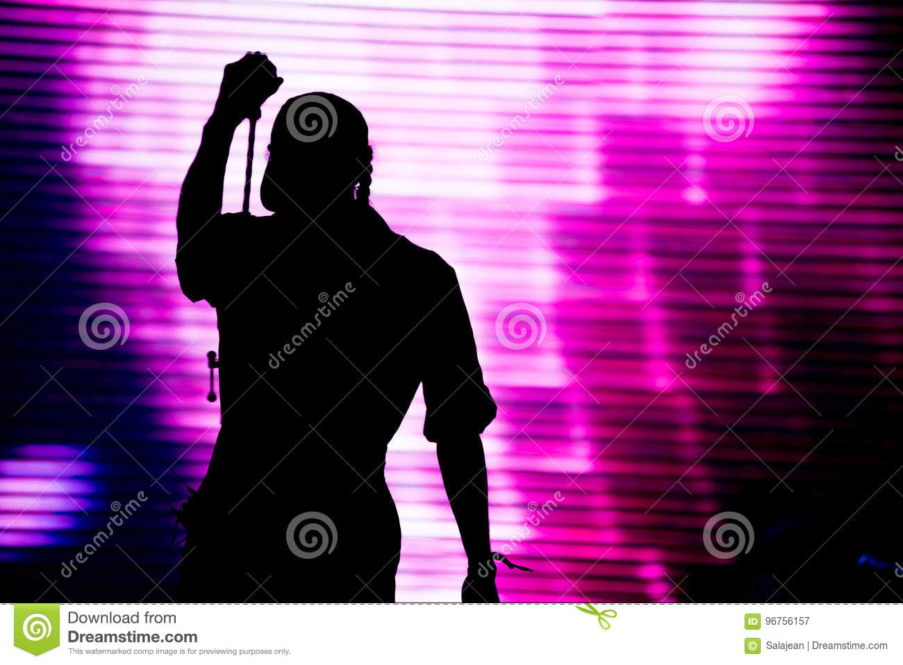 Silhouette of an artist singing live on the stage