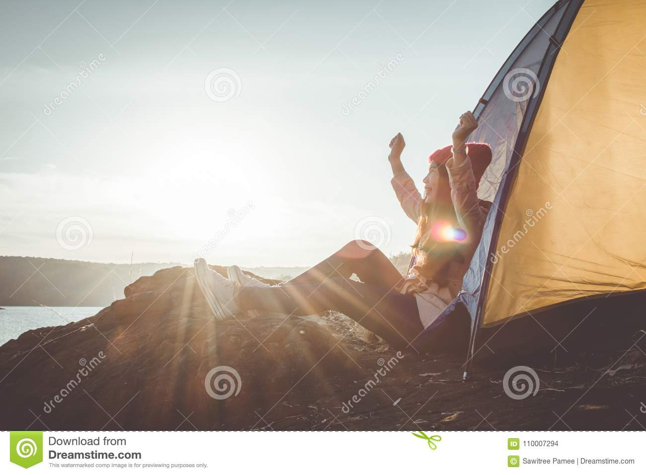 Silhouette Asian woman relaxing in nature winter season during camping