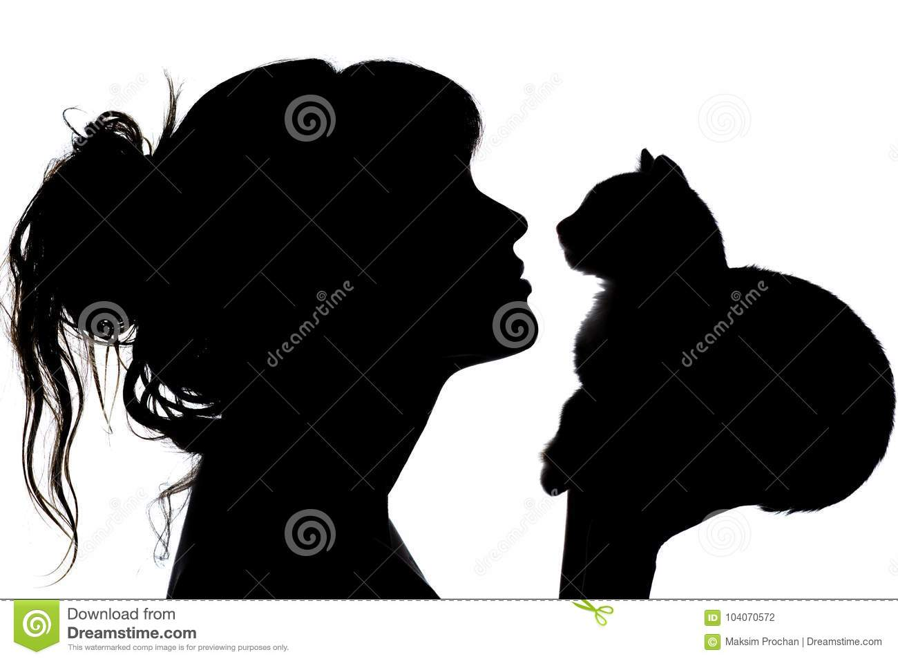 Silhouette of a beautiful woman with wavy hair that nose to nose with a small kitten in her arms, the concept of caring for animal