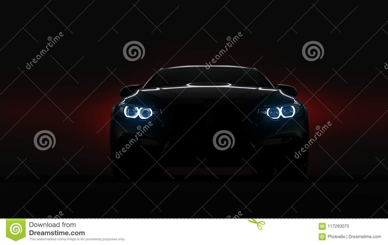 8ffdea59d45 Silhouette of black sports car with headlights on black background