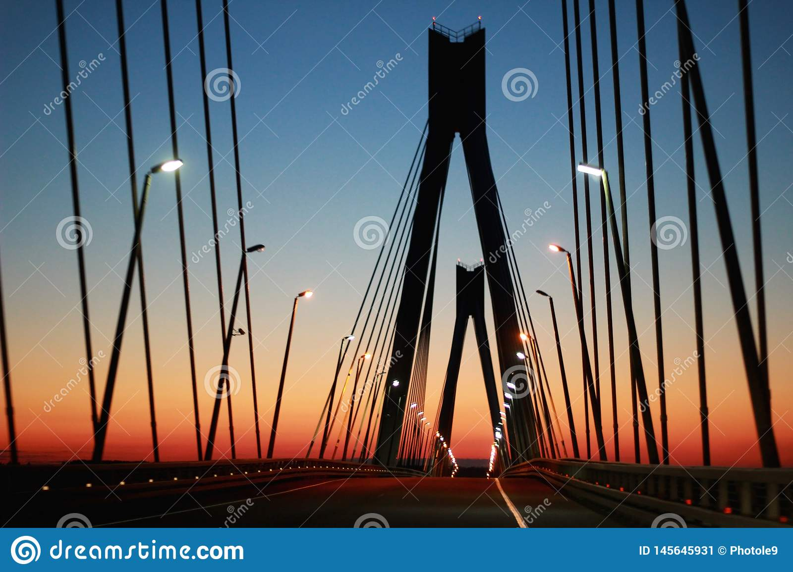 The silhouette of the bridge against the evening sky