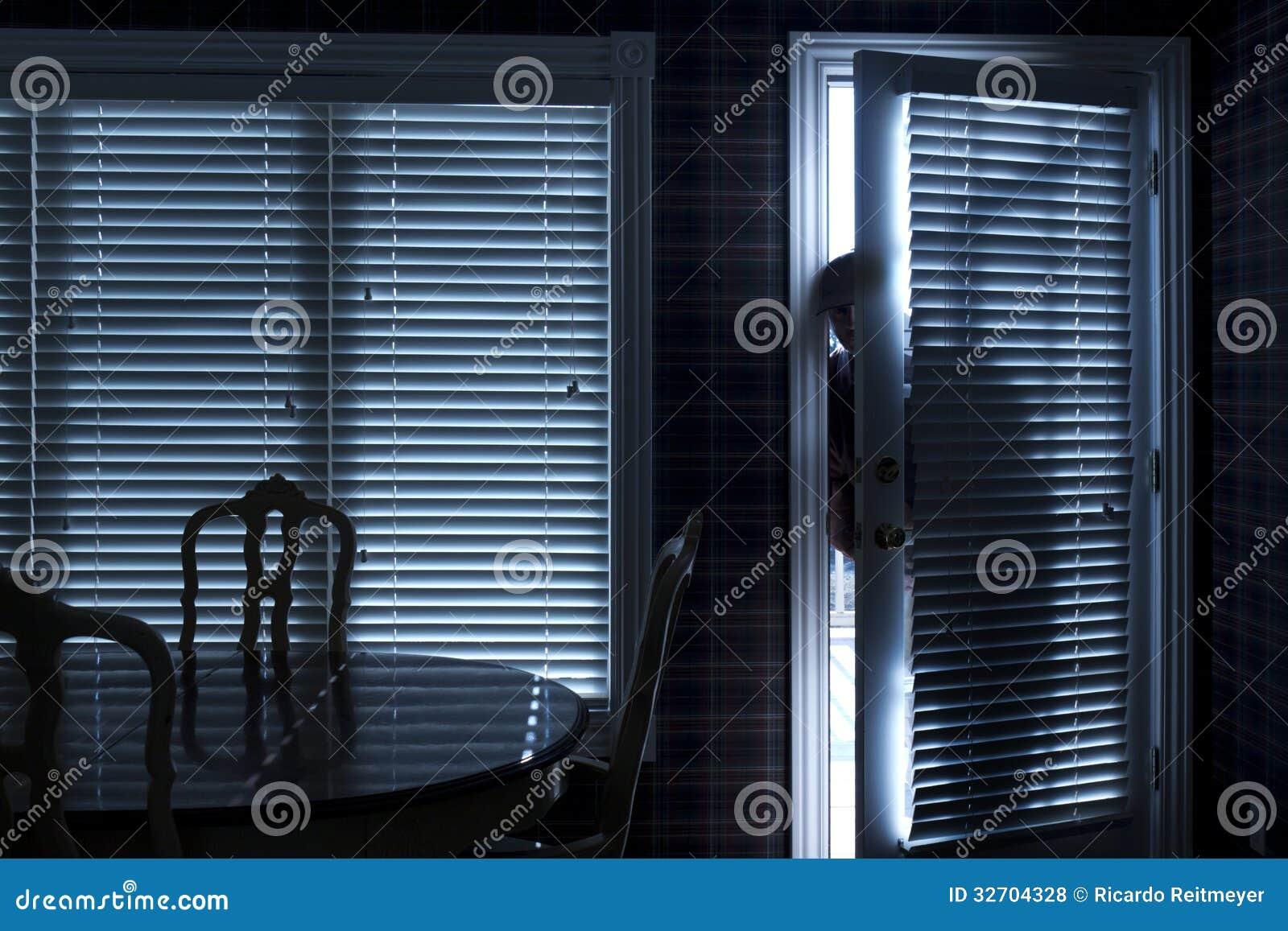 Silhouette Of Burglar Sneeking Up To Backdoor At N Royalty