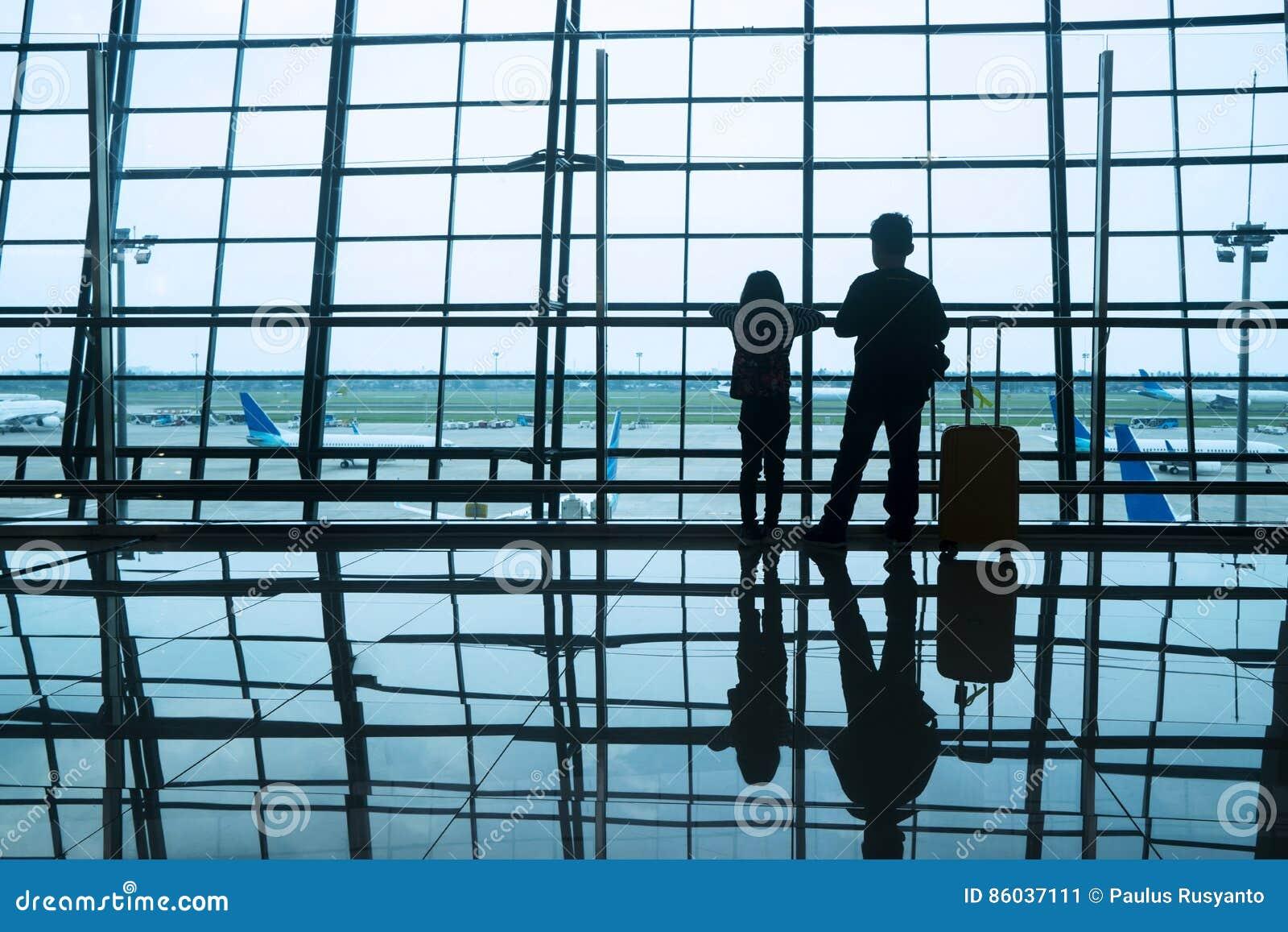 Silhouette children in airport
