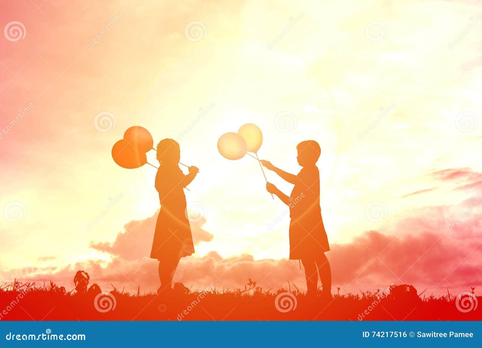 Silhouette children with balloon